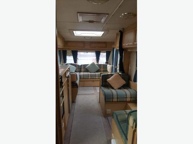 4 berth caravan - Compass, 2000, l shape lounge, motor mover, awning