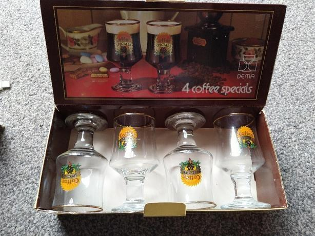 Four glass cups set