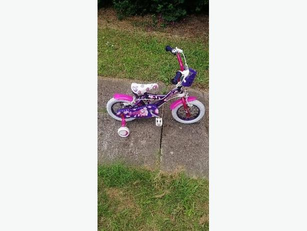 girls bike with stabilizers - £10 - great condition -
