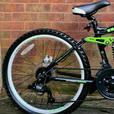 "Carrera detonate mountain bike,24""wheels,21 speed,dual discbrakes"