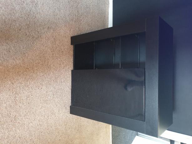 Black  unit with  glass  shelves
