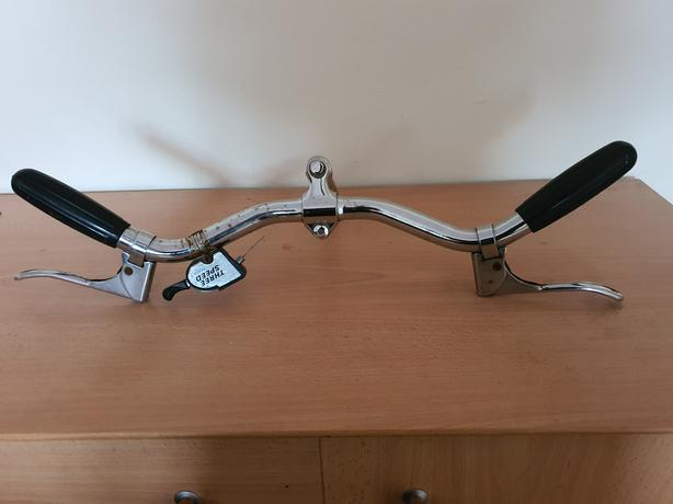 Vintage handlebars with 3 speed gear shifters.