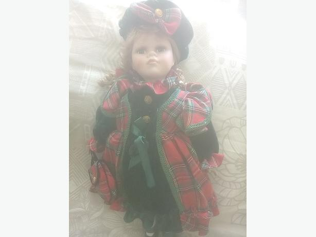 porcelain doll lovely cond as new