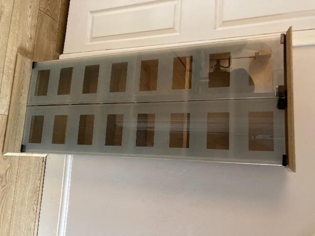 Glass fronted tall unit