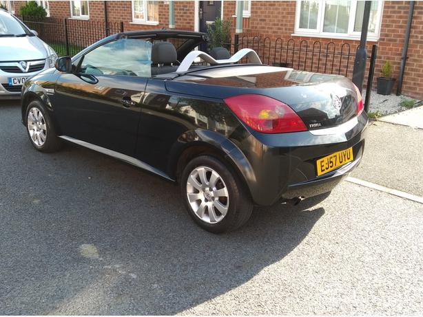 Affordable black Sports convertible with new mot.