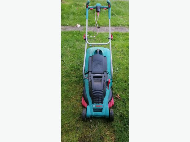 Bosch lawnmower - metal blade - 7 height settings - delivery -