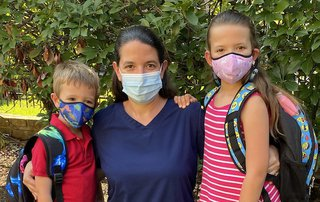 Doctor and children wearing masks