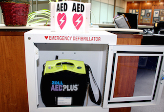 AED step three - locate emergency defibrillator