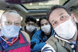 Family-car-masks-COVID-320x213.jpg