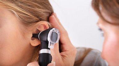 Provider examining a woman's ear - Otolaryngology