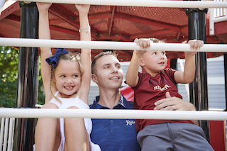 Photo of Scott Burchett and his two older children.