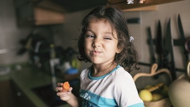 Girl working in garage with parent - Pediatric Digestive Disease