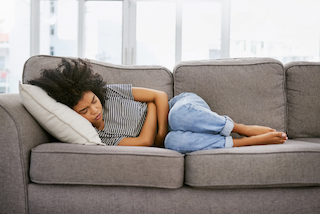 Woman_Laying_on_Couch_320