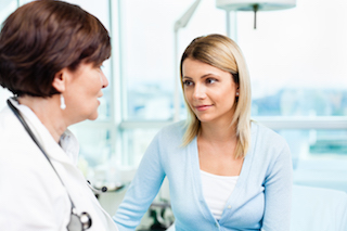 Woman speaking with doctor.