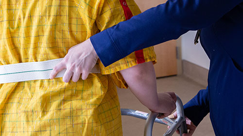 Nurse supporting a patient during rehabilitation