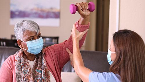 Nurse helping patient during rehabilitation
