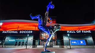 The soccer statue in front of the Frisco National Soccer Hall of Fame.