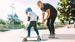 Father and son at a skate park