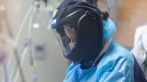 Nurse wearing full specialized PPE in the COVID-19 ward