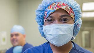 Nurse in a mask facing the camera