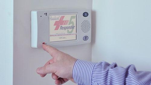 Man pressing the responder alert button