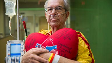 recovering-patient-holding-heart-pillow-transplant-center-utsw.jpg