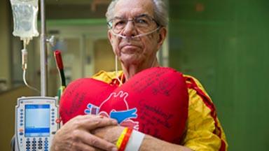 recovering-patient-holding-heart-pillow-transplant-center-utsw.jpg
