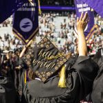 Photo of graduates in caps and gowns from the back. On June 15, 2019, the University of Washington honored more than 6,000 graduates in the 144th Annual Commencement Exercises at Husky Stadium. Nearly 13,795 UW degrees were conferred at the Seattle campus in June.​ (Photo by Mark Stone)