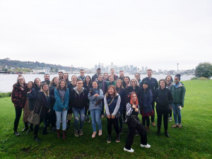 Image of groups of students in the 2+1 student group at Gas Works Park, with Downtown Seattle in the background.