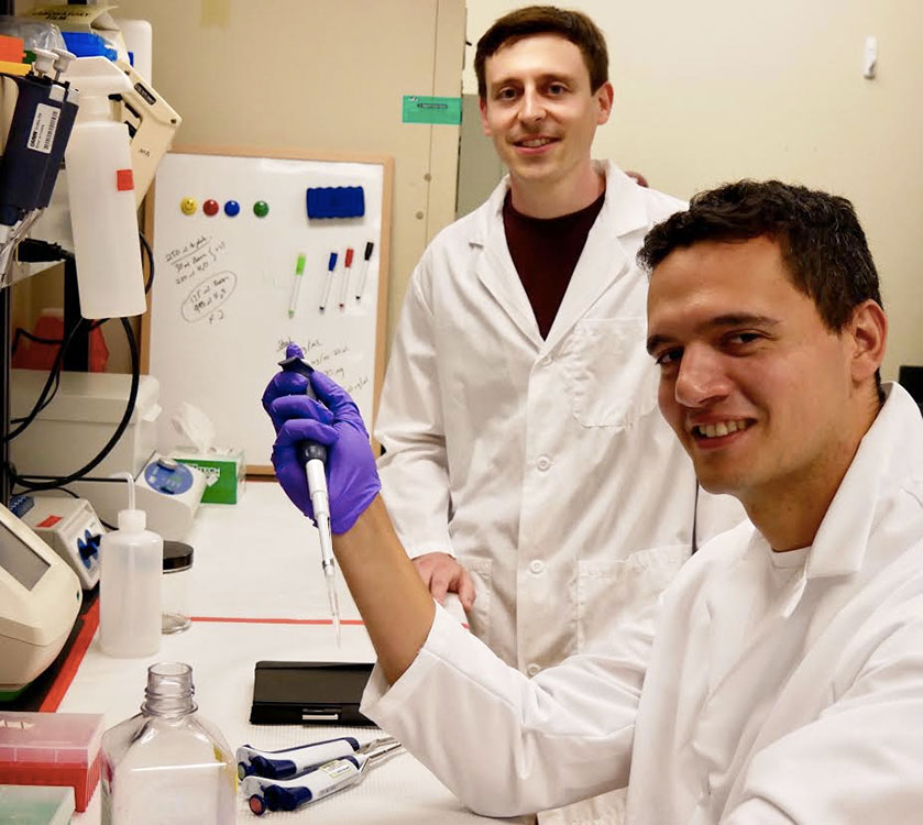 A-Alpha Bio was founded by University of Washington PhD graduates David Younger (standing) and Randolph Lopez. (A-Alpha Bio Photo).
