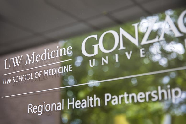 sign on glass wall saying UW School of Medicine, Gonzaga University, Regional Health Partnership