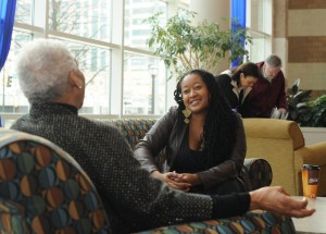LaShawnDa Pittman interviewing a grandmother for her research. (Photo credit is courtesy of LaShawnDa Pittman)