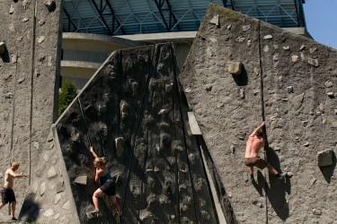 University of Washington students rock climbing near the Husky Stadium.