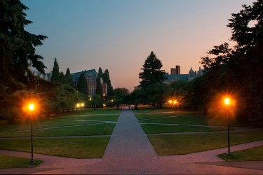 Lighted walkways at dusk on the University of Washington campus.