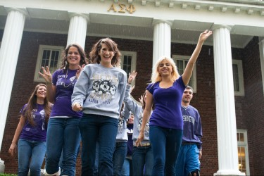 Sorority sisters celebrating a Husky football win.