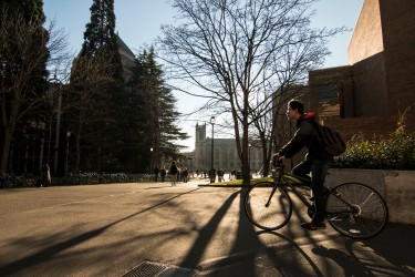 SStudents and visitors walking and biking around the Quad.