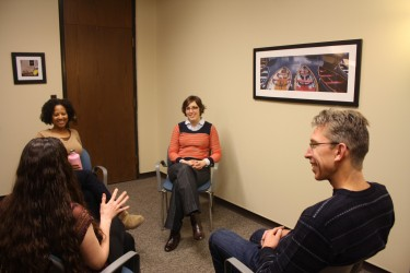 People in a circle talking at the Counseling Center.