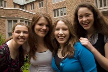 Four smiling students.