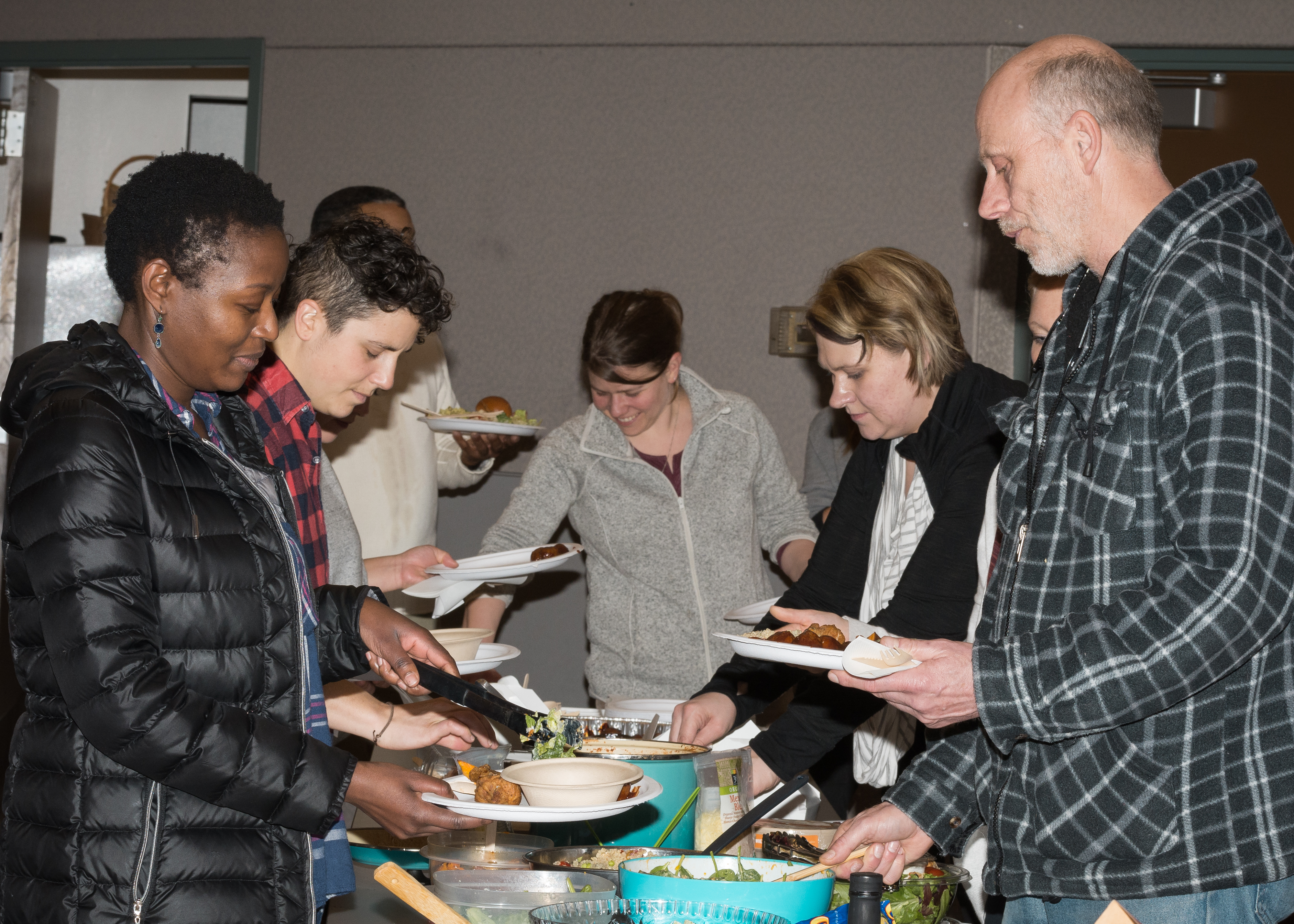 Tent City 3 residents and students, faculty and staff from the School of Nursing at a potluck dinner