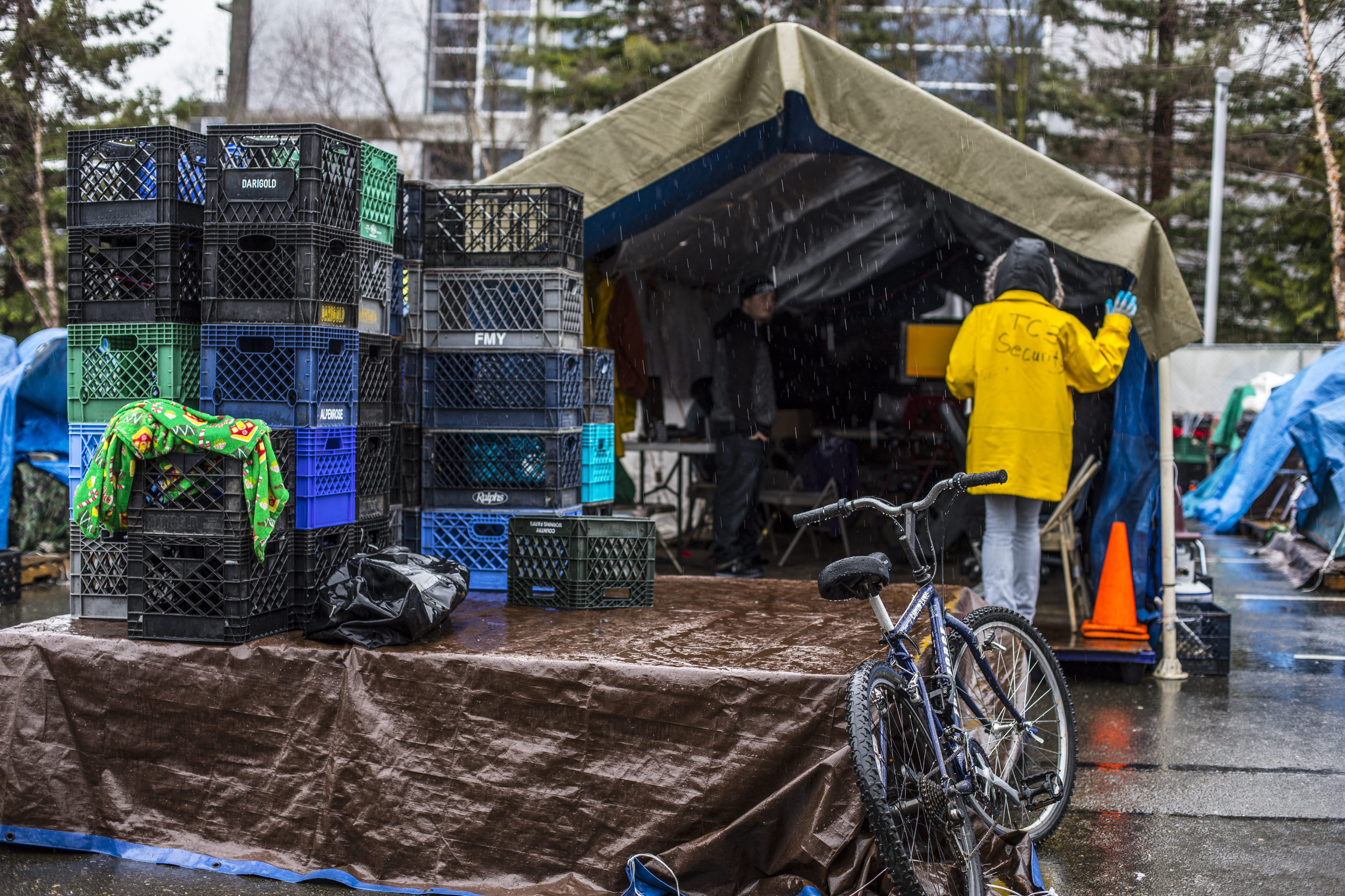 Tent City 3's security patrol checks on a tent