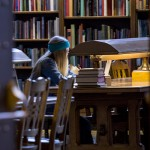 Woman studying in Suzzallo Reading Room