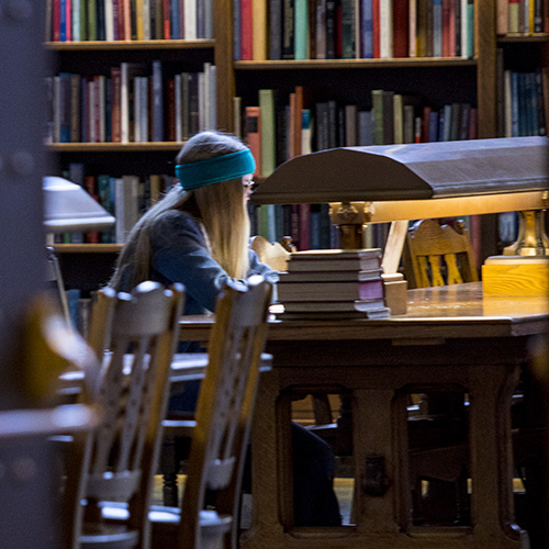 Image of woman studying in Suzzallo Library Reading Room