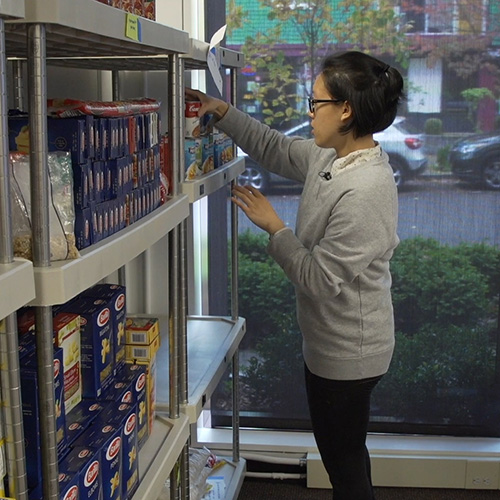 Image of student at the Any Hungry Husky food pantry
