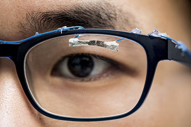 Image of a wearable sensor on a pair of eyeglasses