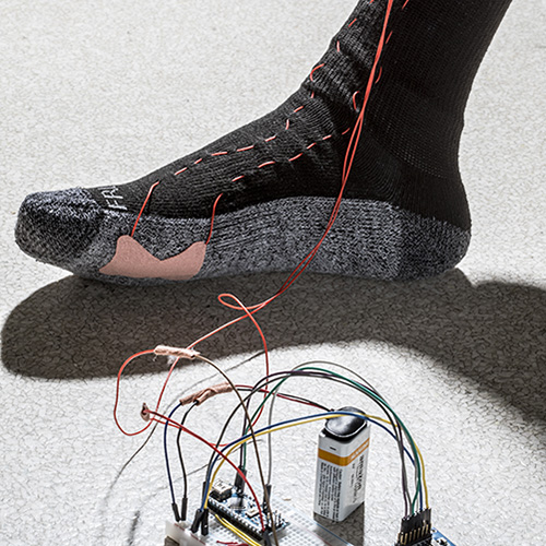 Image of a wearable device on someone's foot