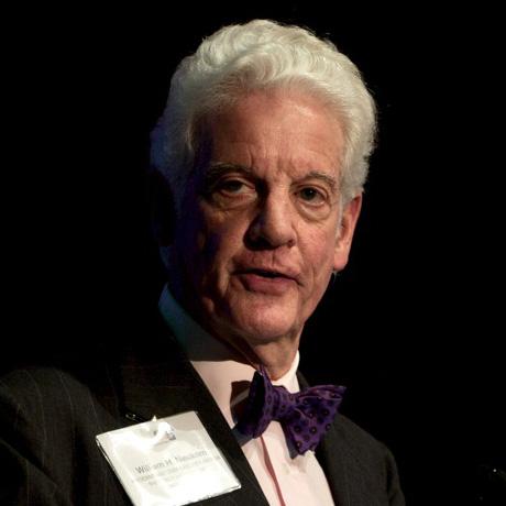 Image Bill Neukom speaking from a podium