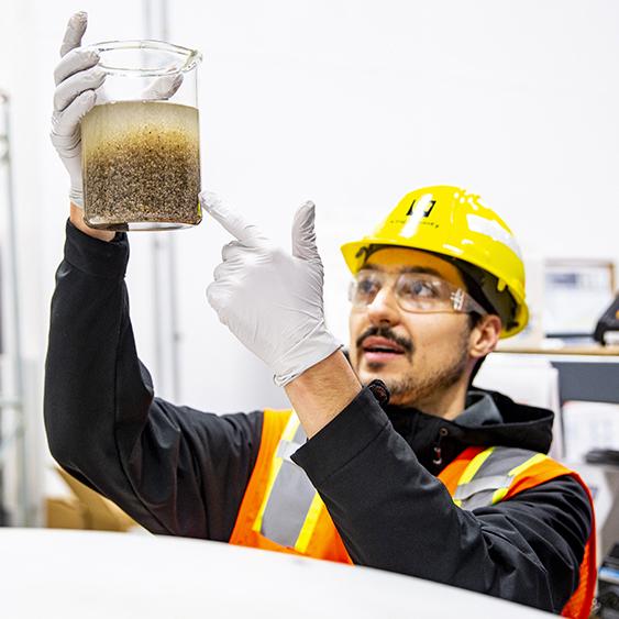 Maxwell Armenta observes the fast-settling properties of granular sludge