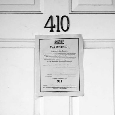 Image of eviction notice posted on a door