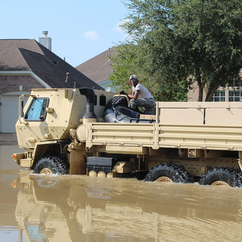 National Guard team responds to flood conditions in a suburban neighborhood