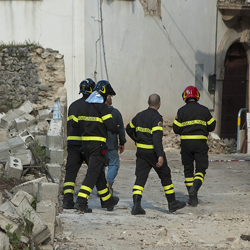 Image of rescue workers amidst earthquake rubble
